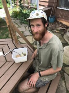 Sam having lunch at a table outside